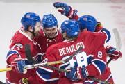 Les joueurs du Tricolore célèbrent le but de... (La Presse canadienne, Graham Hughes) - image 4.0