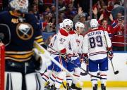 Les joueurs du Canadien célèbrent le but de... (REUTERS) - image 2.0