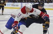 Brendan Gallagher contourne le défenseur des Sabres, Zach... (AP, Jeffrey T. Barnes) - image 5.0