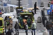 Des secouristes sont à l'oeuvre près de l'endroit... (AFP, Fredrik SANDBERG) - image 2.0
