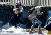 Des heurts avec les forces de l'ordre ont... (AFP, FEDERICO PARRA) - image 1.1