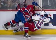 Jordie Benn a coincé Tanner Glass le long... (La Presse canadienne, Paul Chiasson) - image 5.0