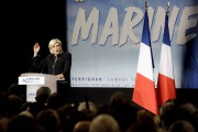 Marine Le Pen s'est attaquée à Emmanuel Macron... (AP, Claude Paris) - image 2.0