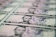 Le dollar américain s'est déprécié de 2% au... (PHOTOAndrew Harrer, Archives Bloomberg) - image 1.0