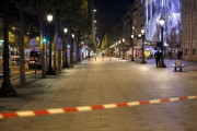 Police seal off the Champs Elysees avenue in... (AP, Thibault Camus) - image 2.0