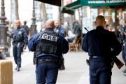 La panique causée par l'irruption d'un homme armé... (AFP, Geoffroy Van Der Hasselt) - image 1.0