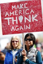 Berneice Hwang, of Boulder, Colo., holds a placard... (AP, David Zalubowski) - image 2.0