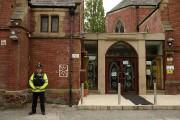 La mosquée de Didsbury est surveillée par la... (AFP) - image 4.0