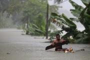 Il s'agit des pires inondations au Sri Lanka... (Photo Eranga Jayawardena, Associated Press) - image 1.0