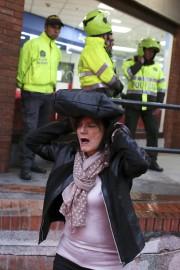 Une femme quitte les lieux de l'explosion.... (Photo Ricardo Mazalan, AP) - image 1.0