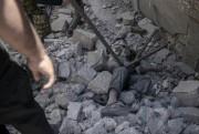 Des cadavres jonchent le sol du quartier.... (AFP, MOHAMED EL-SHAHED) - image 2.0