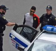 Une fois maîtrisé, le suspect a été sommairement... (Photo courtoisie) - image 1.1