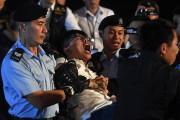 Le militant Joshua Wong a été arrêté après... (PHOTO Anthony WALLACE, AFP) - image 1.0
