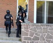 Les policiers avaient revêtu leur équipement pour intervenir.... (Le Progrès, Rocket Lavoie) - image 1.0