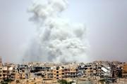Les frappes aériennes de la coalition internationale font... (AFP, Delil Souleiman) - image 2.0