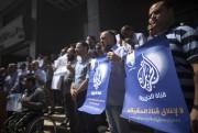 Des journalistes palestiniens protestent à Gaza. «Être un... (PHOTO MAHMUD HAMS, AGENCE FRANCE-PRESSE) - image 1.0