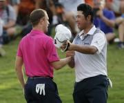 Justin Thomas et Hideki Matsuyama.... (AP) - image 2.0