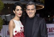 George et Amal Clooney... (AP, Jordan Strauss) - image 2.0