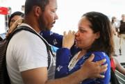 Une survivante du naufrage de Bahia semblait toujours... (AFP) - image 2.0