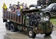 Les camions d'évacuation n'ont pas chômé à Houston,... (AP, Melissa Phillip) - image 3.0