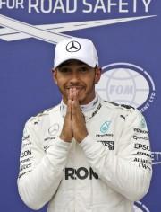 Lewis Hamilton a signé samedi sa 69e pole... (AP, Luca Bruno) - image 3.0