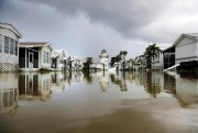 A mobile home community is flooded in the... (photoDavid Goldman, associated press) - image 1.1
