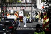L'attentat est survenu vendredi matin dans une rame... (PHOTO KIRSTY WIGGLESWORTH, ARCHIVES AFP) - image 1.0