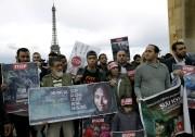 À Paris, des manifestants ont marché, samedi, afin... (AFP, Thomas Samson) - image 2.0
