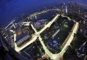 Singapour, vue du ciel. Les rues illluminées montrent... - image 1.0