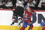 Brendan Gallagher est solidement frappé par Jordan Martinook... (PHOTO BERNARD BRAULT, LA PRESSE) - image 1.0