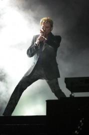Johnny Hallyday en spectacle au Théâtre St-Denis, en... (photoDenis Courville, archives La Presse) - image 2.0