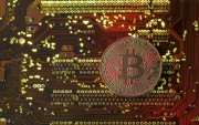 FILE PHOTO: A copy of bitcoin standing on... (REUTERS) - image 2.0