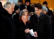 Philippe Couillard,Régis Labeaume etJustin Trudeau étaient réunis lundi... (REUTERS) - image 2.0