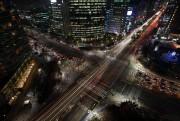 À l'heure de pointe, l'arrondissement chic de Gangnam... (PHoto Seong Joon-cho, archives Bloomberg) - image 1.0