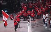 BrianMcKeever a été le porte-drapeau du Canada lors... (AP) - image 2.0