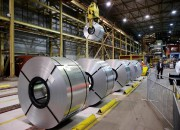 FILE PHOTO: Rolled up steel sits in the... (PHOTO REUTERS) - image 1.0