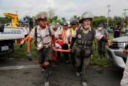 Des secouristes à l'oeuvre dans la ville d'Escuintla.... (REUTERS) - image 2.0