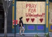 Un message d'encouragement a été inscrit sur unefenêtre... (AP) - image 2.0