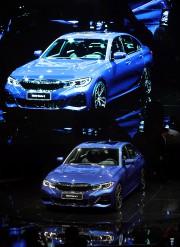 La présentation de la BMW Série 3 au... (Photo PAULO WHITAKER, REUTERS) - image 2.0