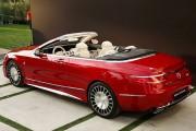 Cette auto rouge peut vous mettre dans le... - image 8.0