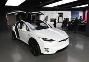 Selon Elon Musk, la technologie Tesla permettra bientôt... (PHOTO MARK RALSTON, AFP) - image 2.0