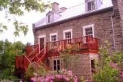 La maison, vue de l'arrière, en été. La... (PHOTO MARTIN CHAMBERLAND, LA PRESSE) - image 3.0