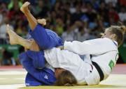 Aux Jeux de Rio, Catherine Beauchemin-Pinard (en blanc)... (PHOTO JACK GUEZ, ARCHIVES AGENCE FRANCE-PRESSE) - image 5.0