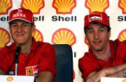 Michael Schumacher et Eddie Irvine en conférence de... (PHOTO AFP) - image 3.0