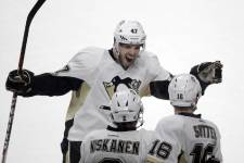 Notre galerie de photos du match remporté en prolongation par les Penguins contre le Canadien.