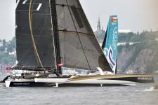 Les deux voiliers de la classe Ultime, le Spindrift 2 et le Musandam Oman Sail, ont pris le départ de laTransat Québec-Saint-Malo,sur le coup de 16h, entre Québec et Lévis.