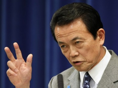 Le premier ministre Taro Aso et son gouvernement... (Photo: Associated Press)