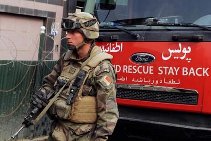 Les familles de soldats tu s en afghanistan portent for Portent en francais