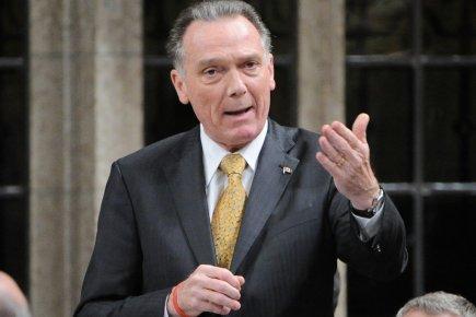 Pour le ministre de l'Environnment du Canada, Peter Kent... (Photo: Sean Kilpatricks, PC)