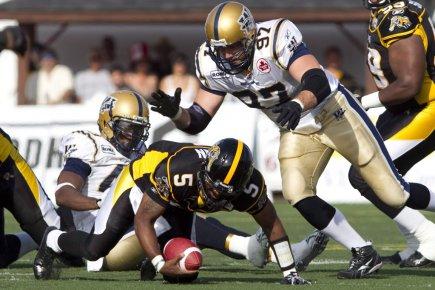 Repêché par les Stampeders de Calgary en 1997,... (Photo : Darren Calabrese, PC)